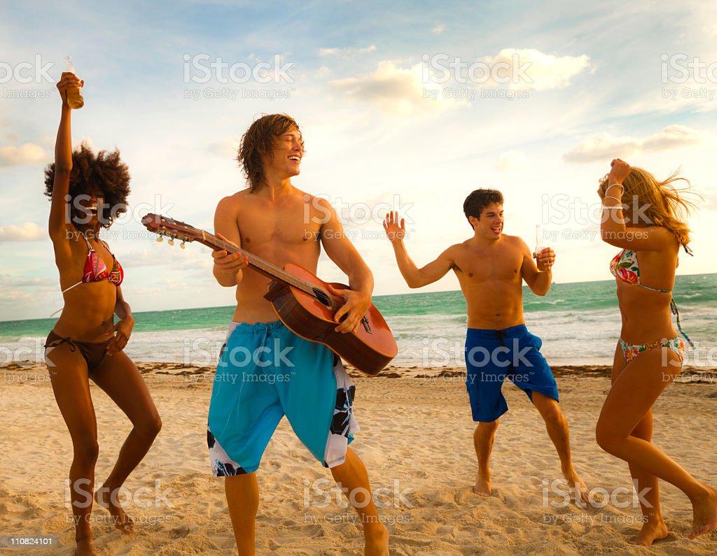 Multi ethnic beach party royalty-free stock photo