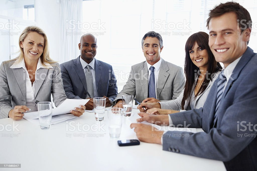 Multi ethnic business associates in meeting room royalty-free stock photo