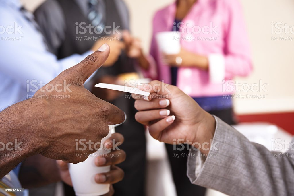 Multi ethnic Business card exchange social with refreshments stock photo