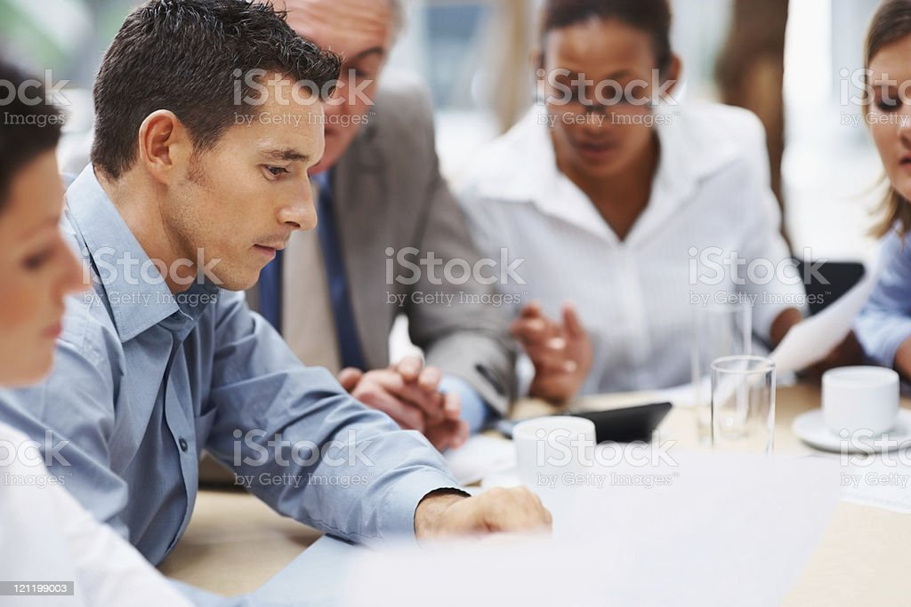 Multi ethnic business people discussing work stock photo