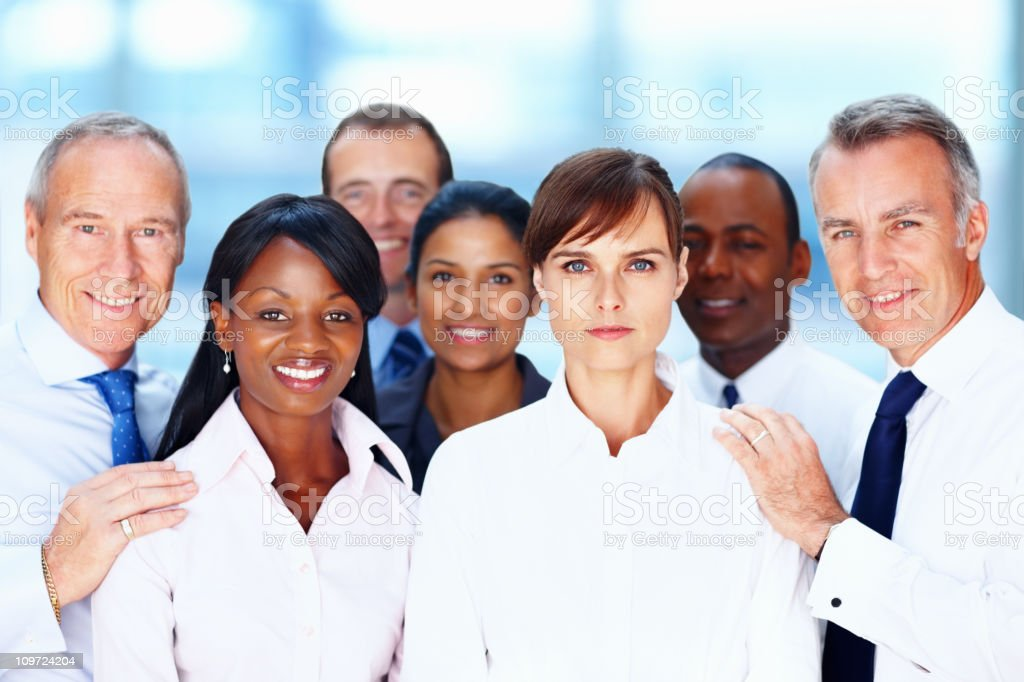 Multi ethnic business people posing for a photograph royalty-free stock photo