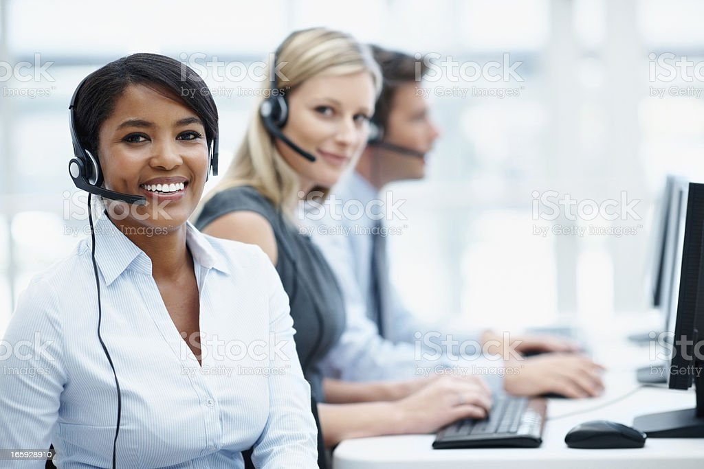 Multi ethnic business team working in a call center royalty-free stock photo