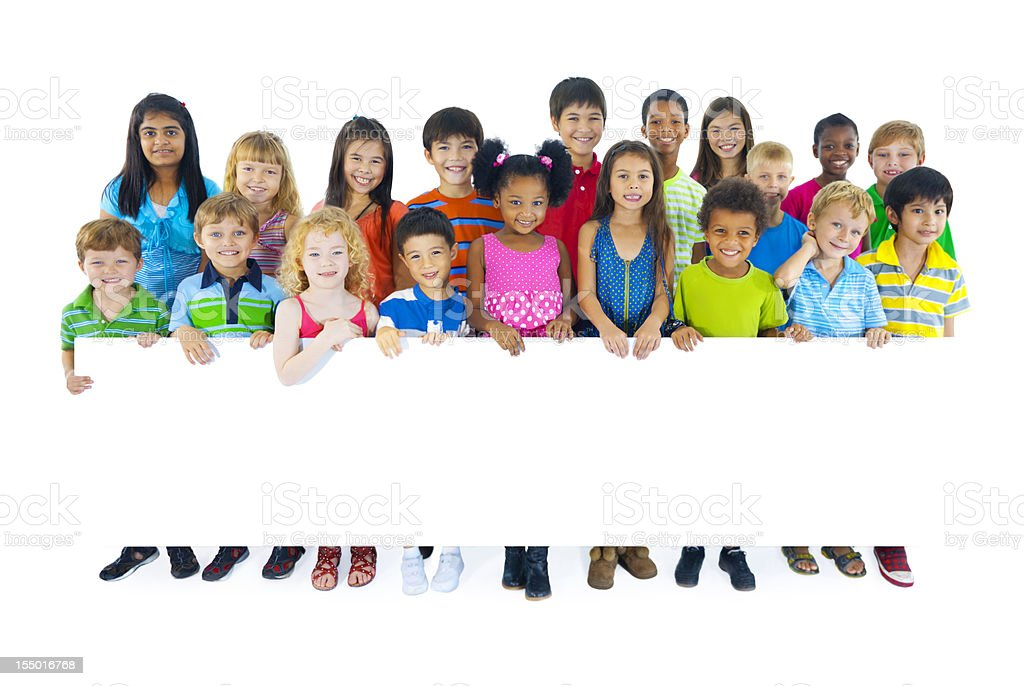 Multi ethnic children holding a blank placard stock photo