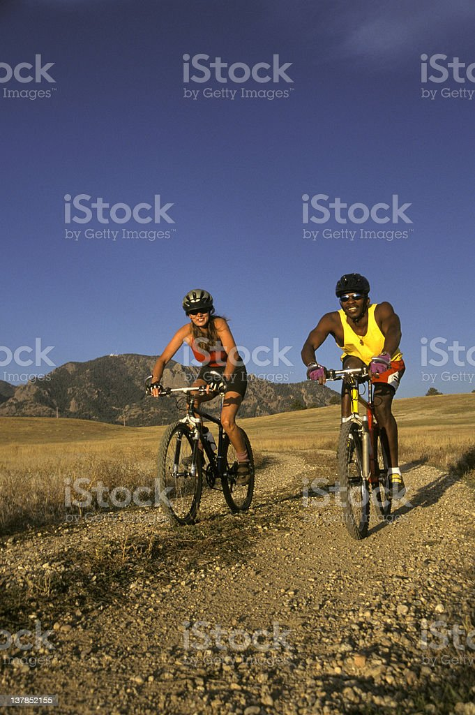 Multi Ethnic Couple Biking royalty-free stock photo
