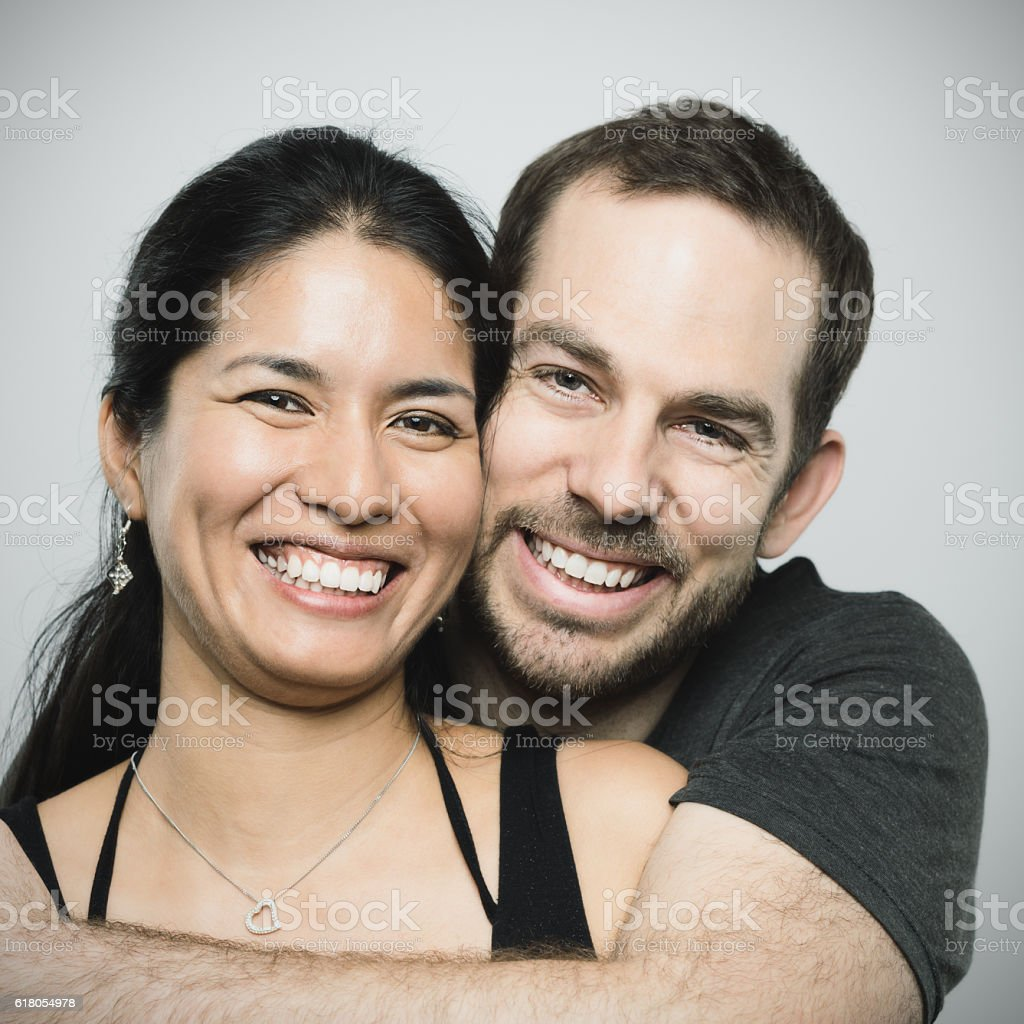 Multi ethnic couple in love portrait. stock photo