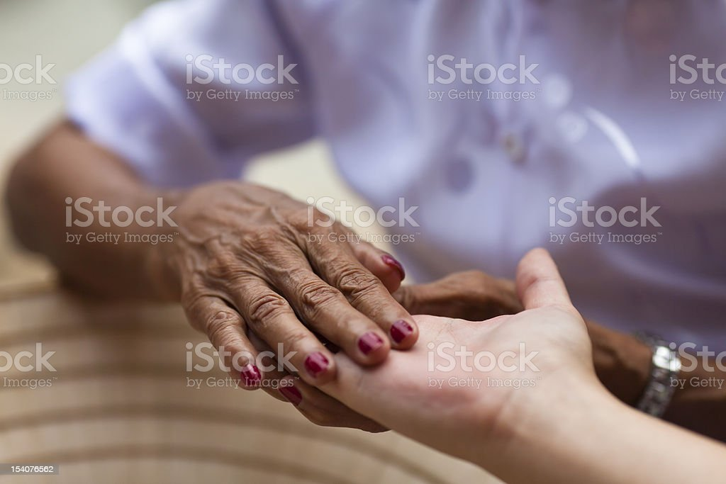 Multi Ethnic Delicate Hands Touching stock photo