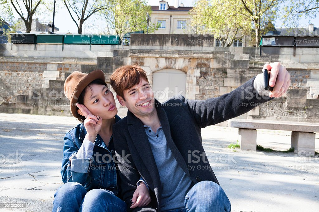 multi ethnic friendstake happy selfie on the banks Seine Paris stock photo