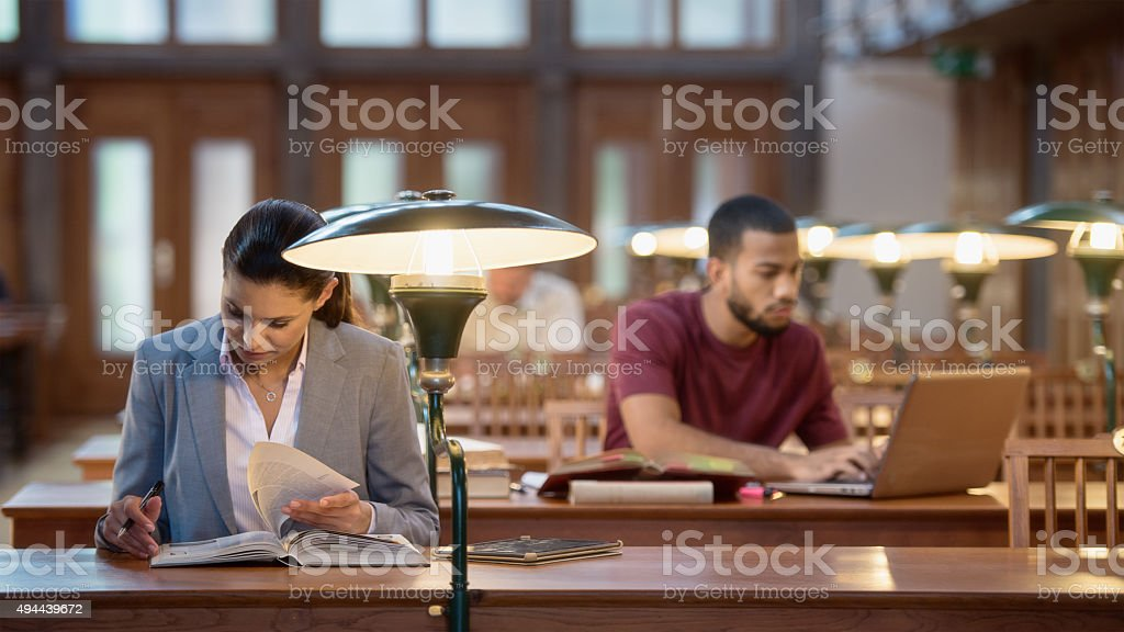 Multi ethnic group of Students Studying in a Library stock photo