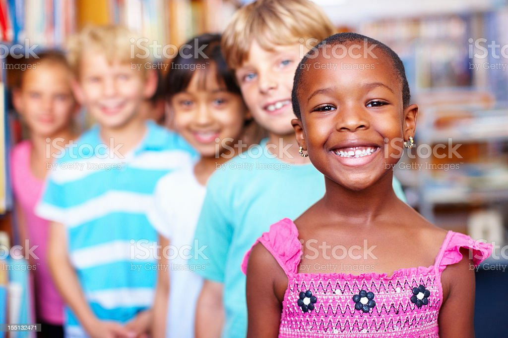 Multi ethnic kids standing in row royalty-free stock photo