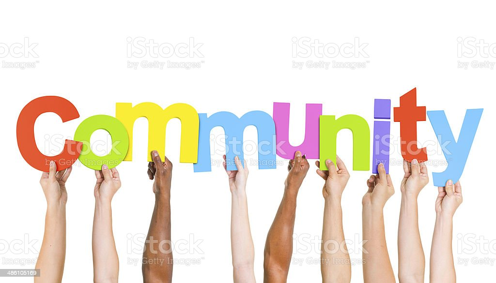 Multi Ethnic People Holding The Word Community stock photo