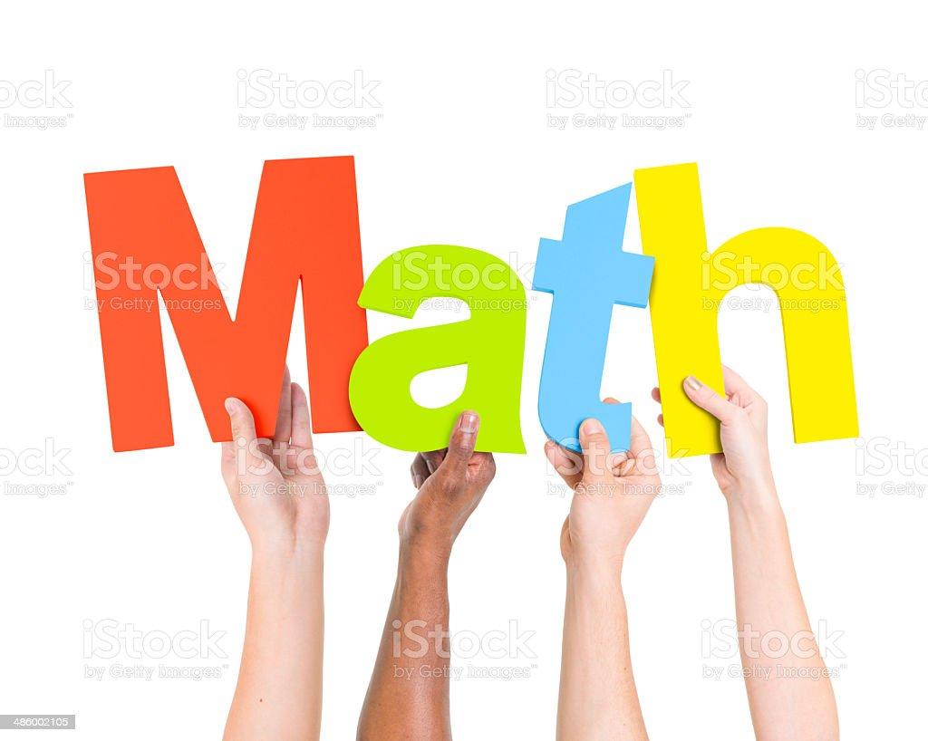 Multi Ethnic People Holding The Word Math stock photo