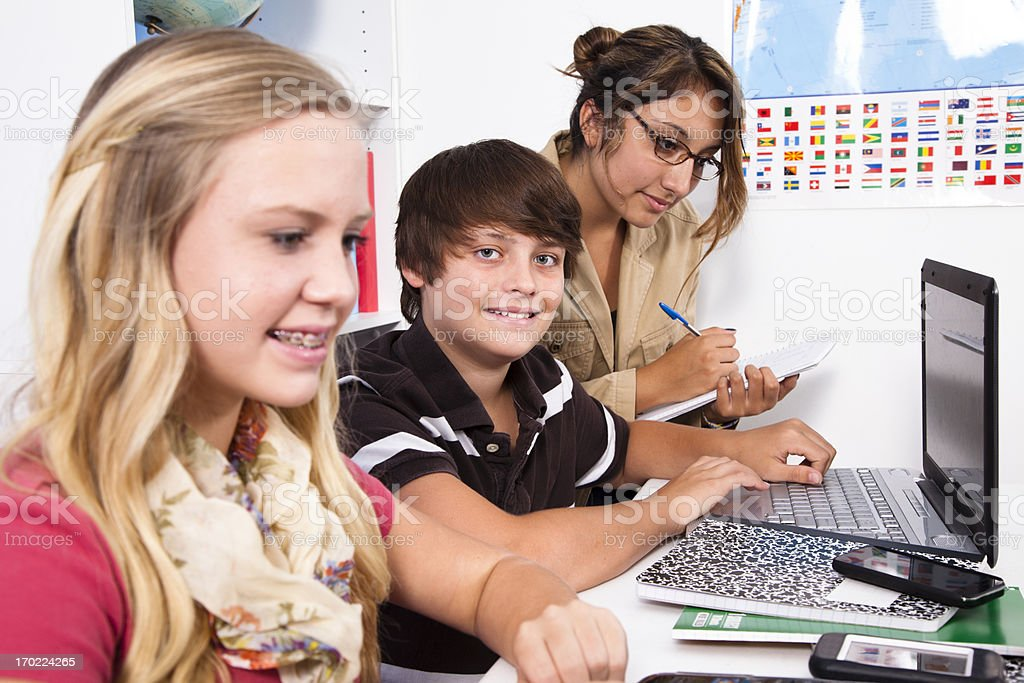 Multi ethnic preteen students in computer lab with instructor. royalty-free stock photo