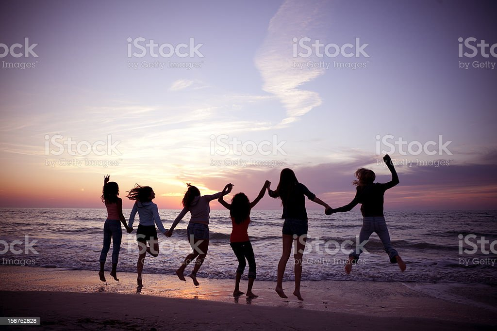 Multi ethnic women at beach royalty-free stock photo