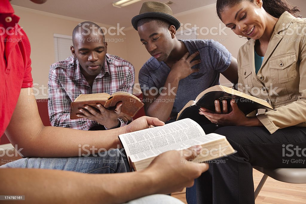 Multi ethnic Young adults in a Bible study. Church. Group. stock photo