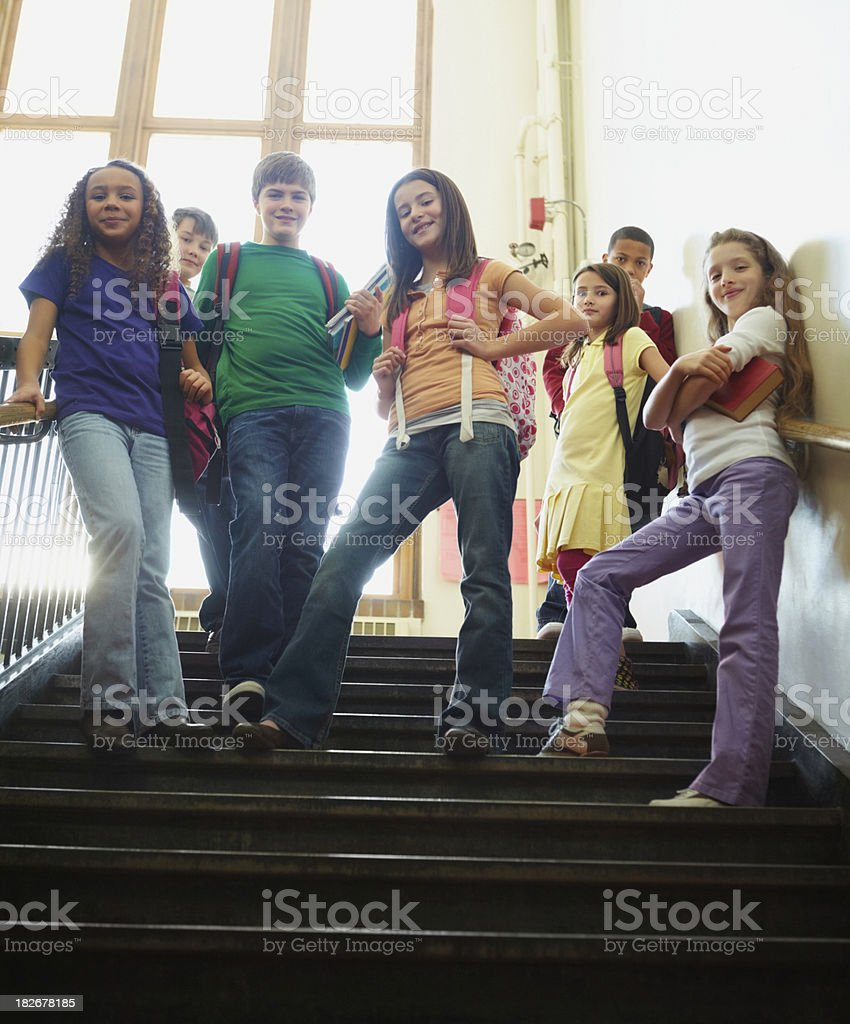 Multi ethnic young children standing together on steps royalty-free stock photo