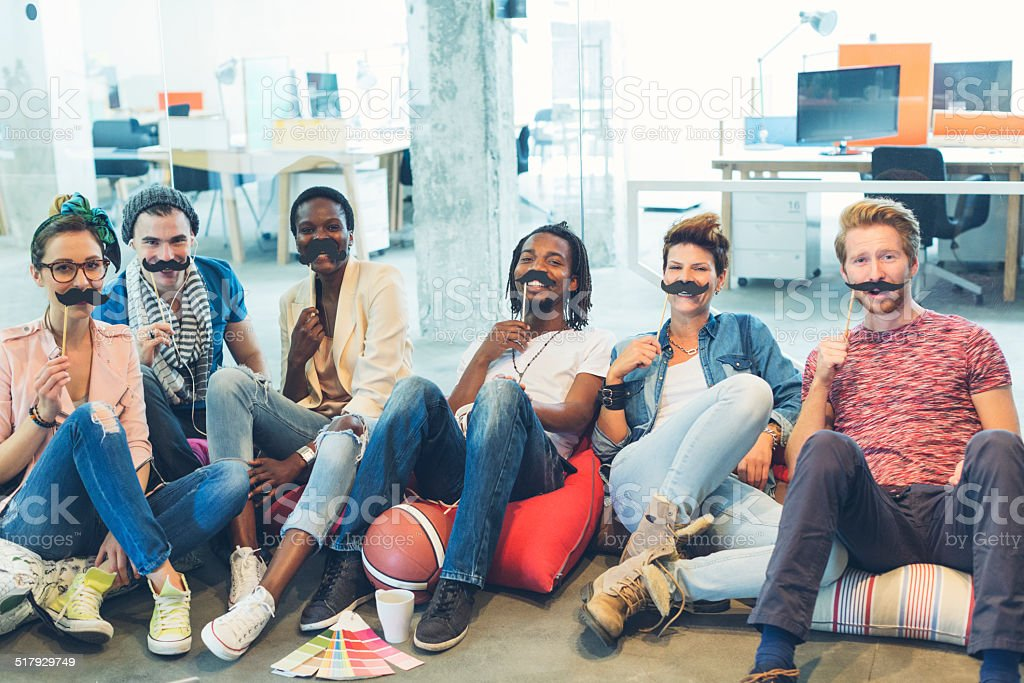Multi Ethnich Group Of young designers involved in Movember Project. stock photo