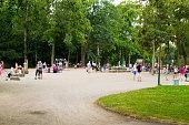 Multi ethnicy families on playground in Hofgarten