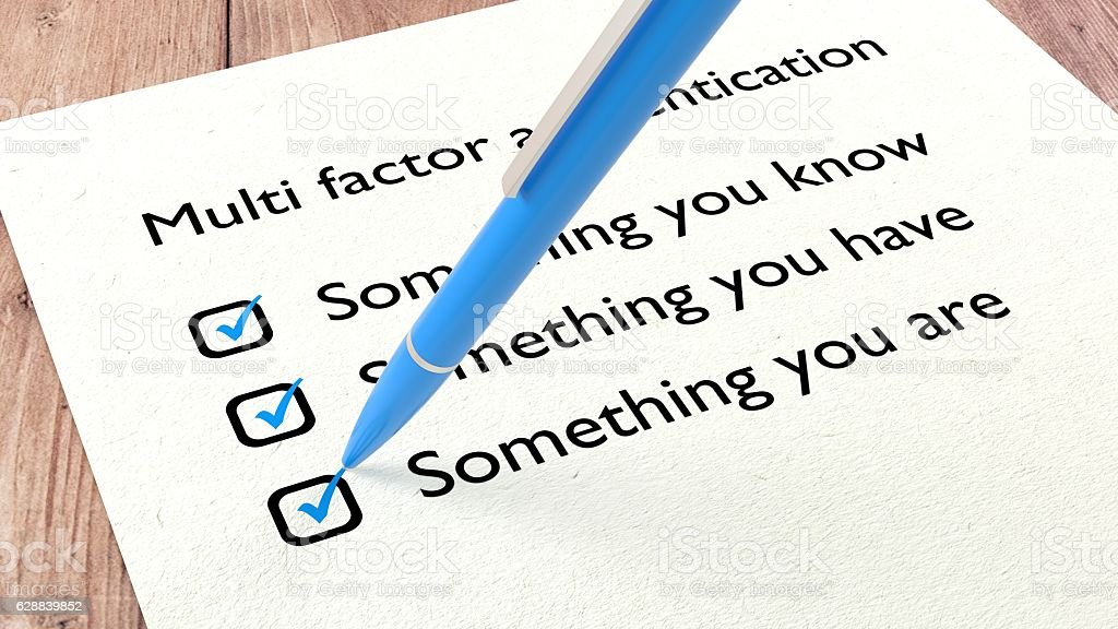Multi factor authentication checklist with a pen stock photo