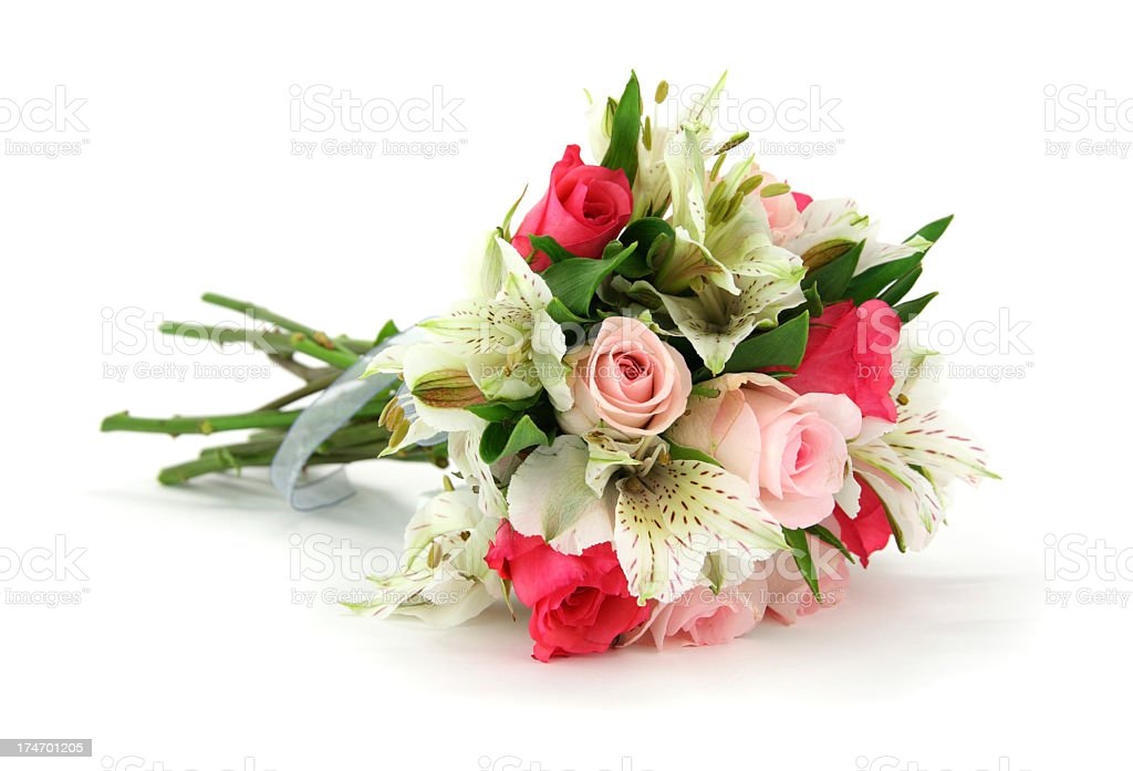 Multi flower bouquet tied with white ribbon lying on side stock photo