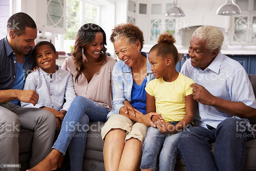 Multi generation black family at home stock photo