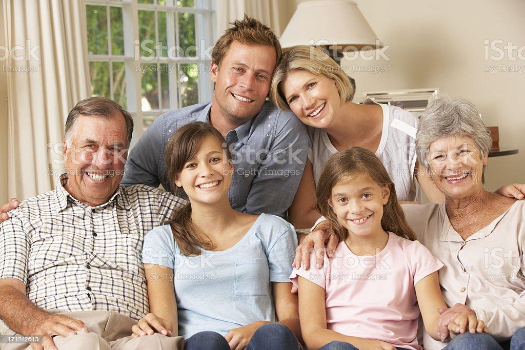 Multi Generation Family Group Sitting On Sofa Indoors royalty-free stock photo