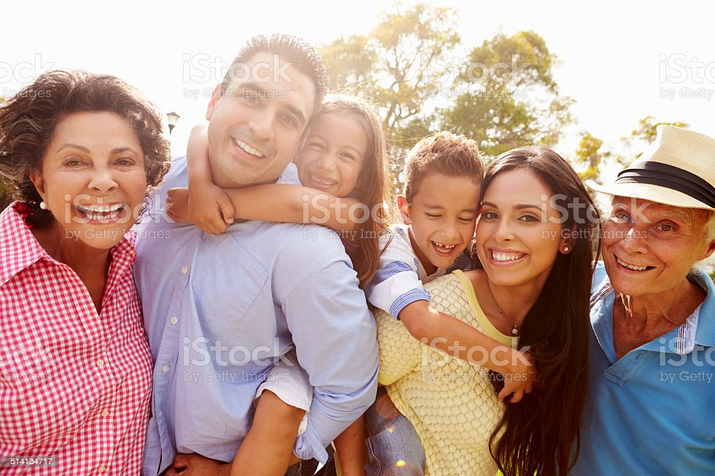 Multi Generation Family Having Fun In Garden Together stock photo