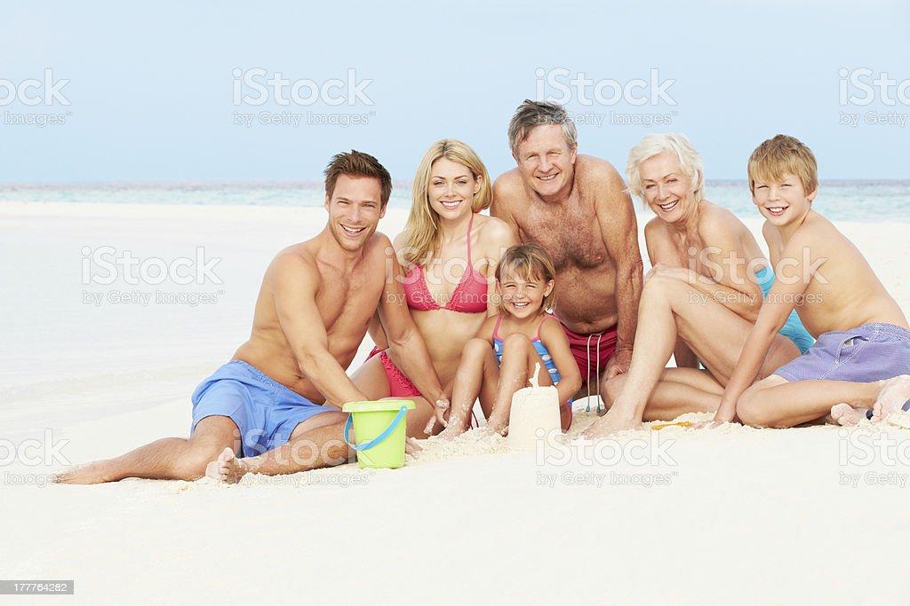 Multi Generation Family Having Fun On Beach Holiday royalty-free stock photo