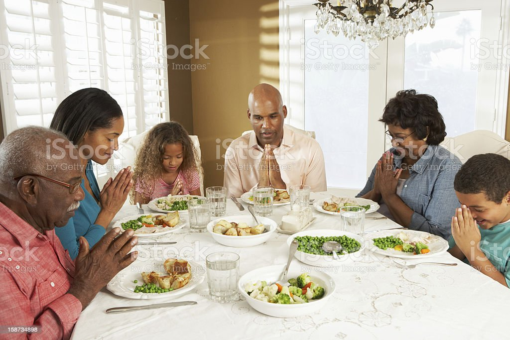 Multi Generation Family Having Meal At Home stock photo