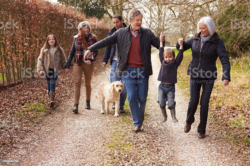 Multi Generation Family On Countryside Walk stock photo