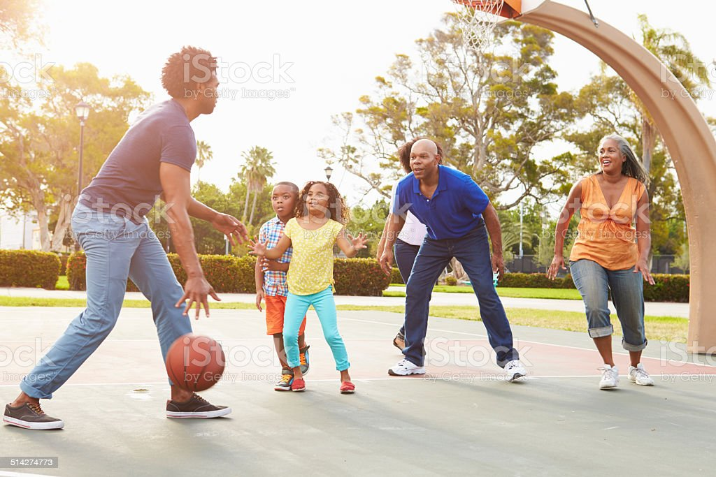 Multi Generation Family Playing Basketball Together stock photo