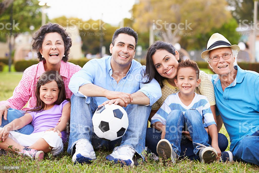 Multi Generation Family Playing Soccer Together stock photo
