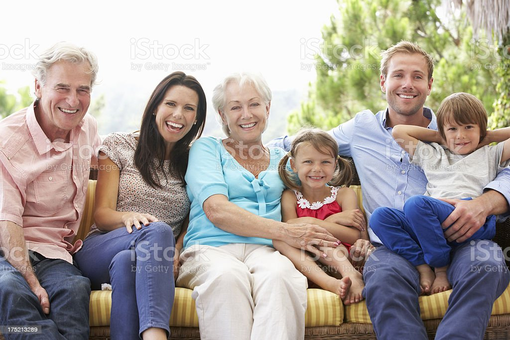 Multi Generation Family Sitting On Garden Seat royalty-free stock photo