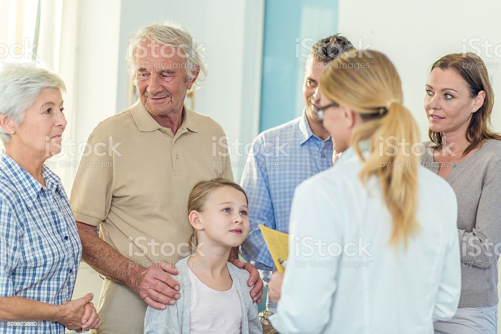 Multi generation family visit at doctor's office stock photo