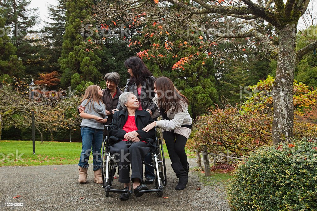Multi generation family with senior woman in wheelchair stock photo