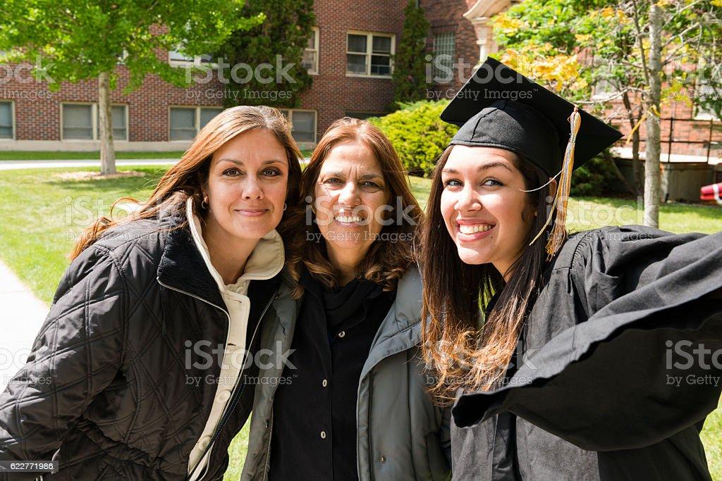 Multi Generational Family American Hispanic Women Celebrating Graduation Day USA stock photo