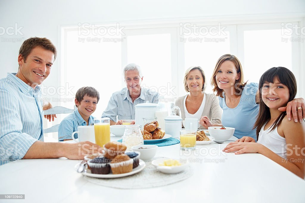 Multi generational family sitting at the breakfast table royalty-free stock photo