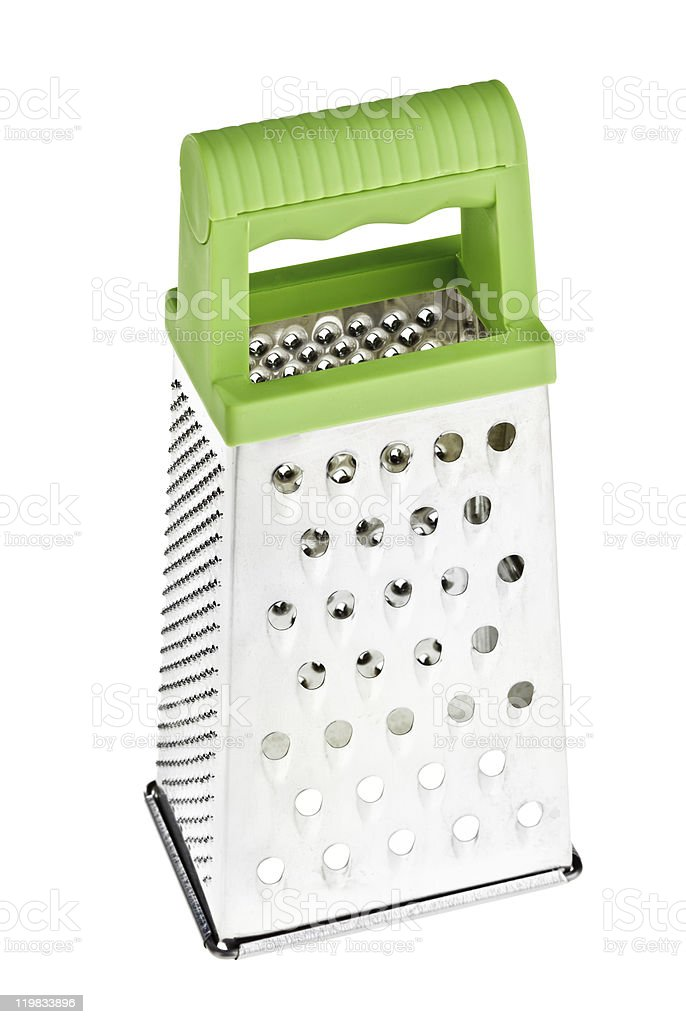 Multi purpose stainless steel grater with green plastic handle stock photo