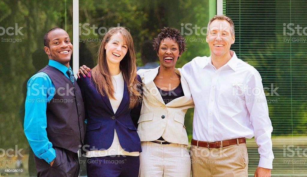 Multi racial business team portrait outdoors stock photo