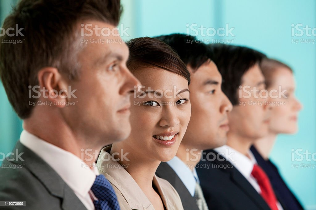 Multi racial businesspeople in a line, portrait stock photo