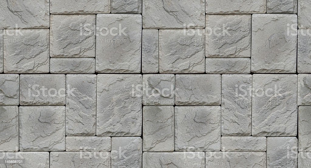 Multi shaped stone gray textured wall royalty-free stock photo