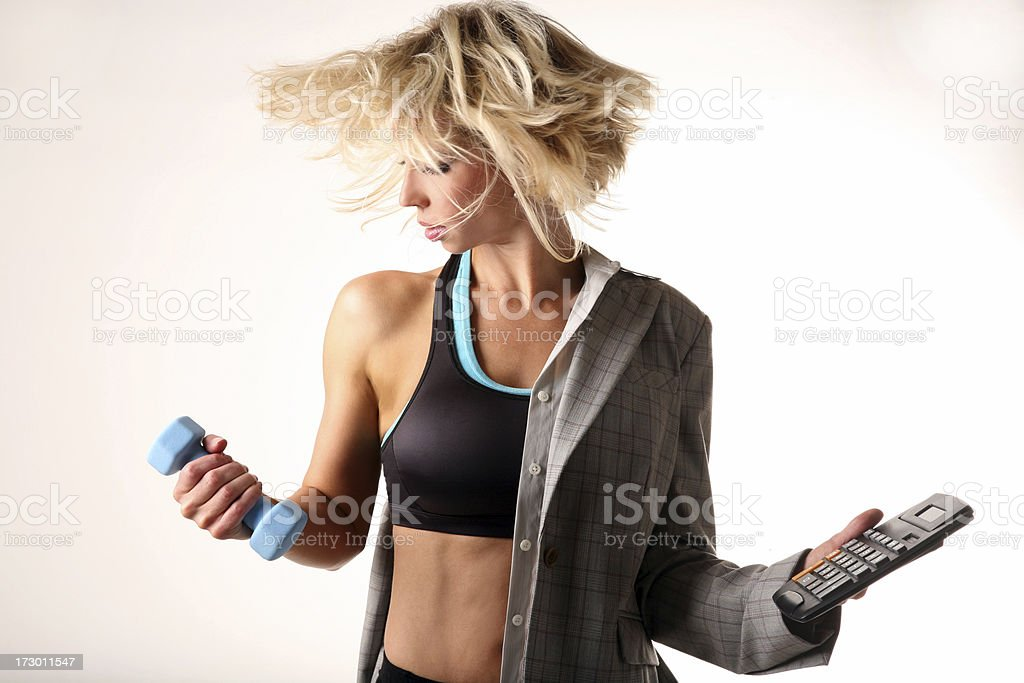 Multi Tasking Business woman balancing life work and fitness stock photo