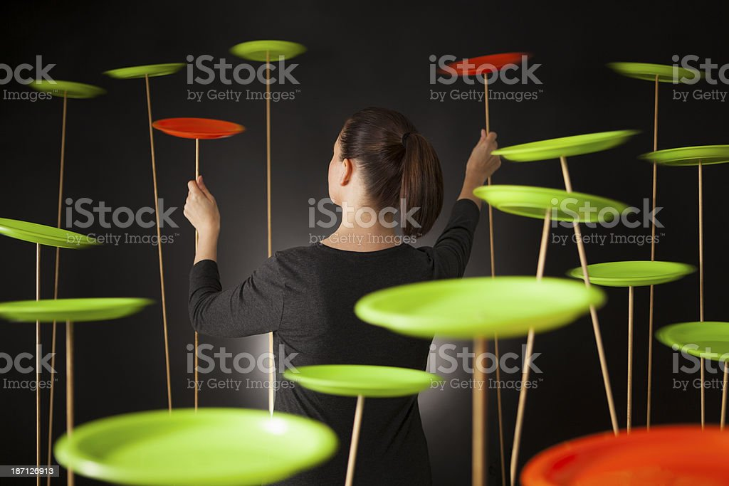 Multi tasking spinning plates stock photo