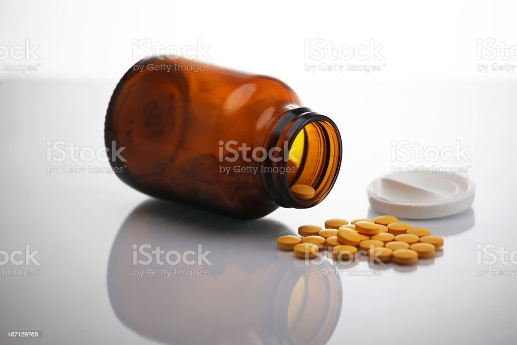 multi vitamin tablets isolated on white stock photo