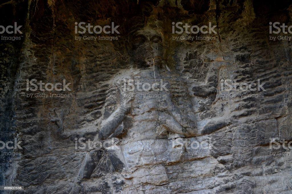 Multi-armed buddhist image at Longmen Grottoes, Luoyang, Henan province, China stock photo