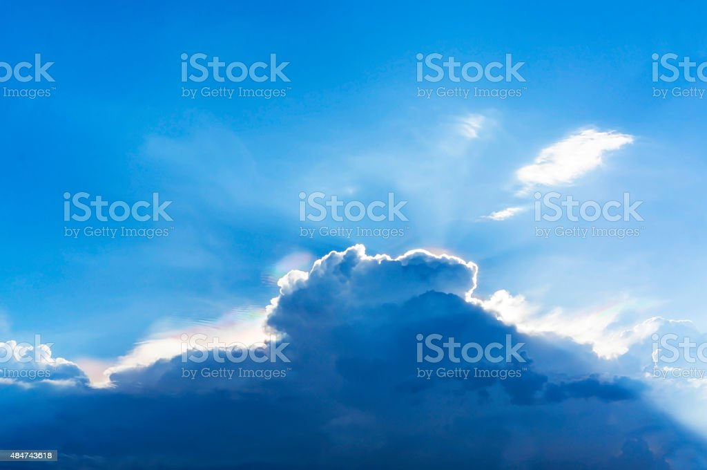Multi-color appear on sky over rainclouds royalty-free stock photo