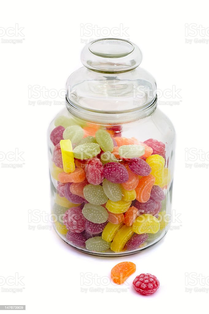 Multicolor bonbons in glass pot royalty-free stock photo