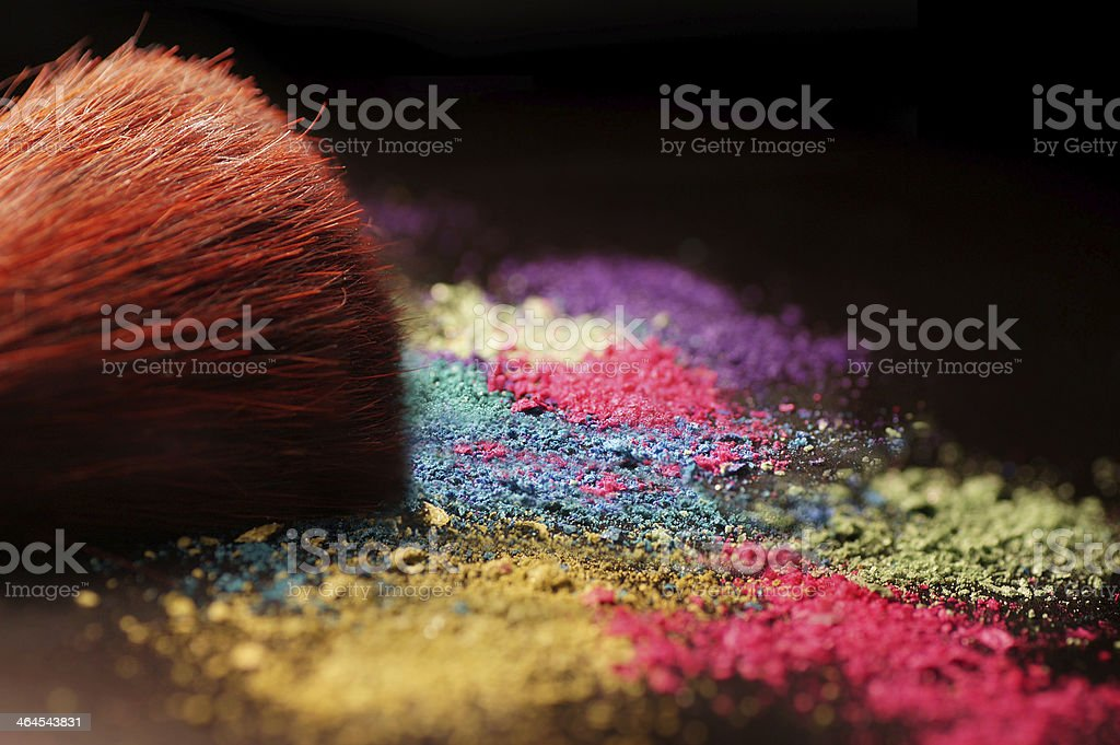 Multicolor crushed eyeshadow and brush stock photo