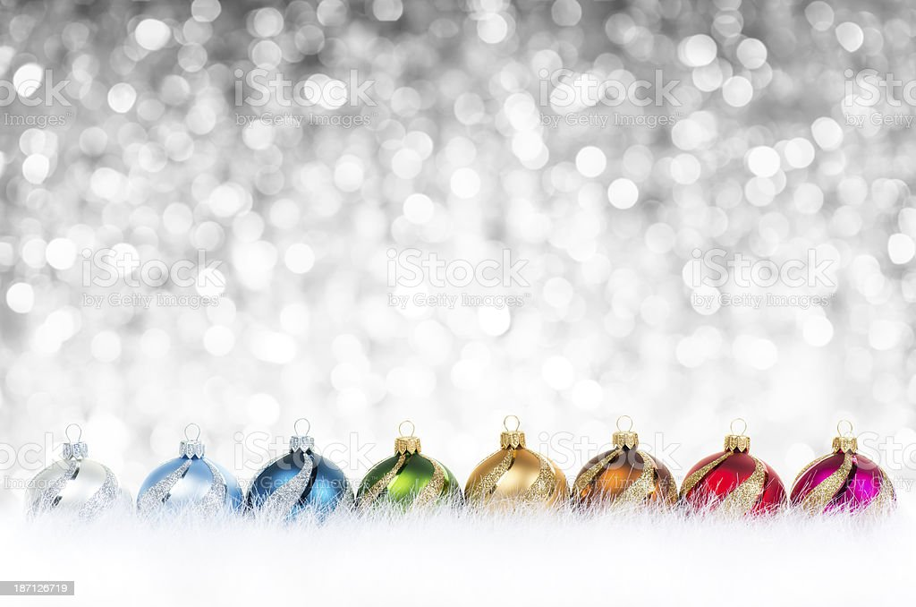 Multicolor decorated baubles in line royalty-free stock photo