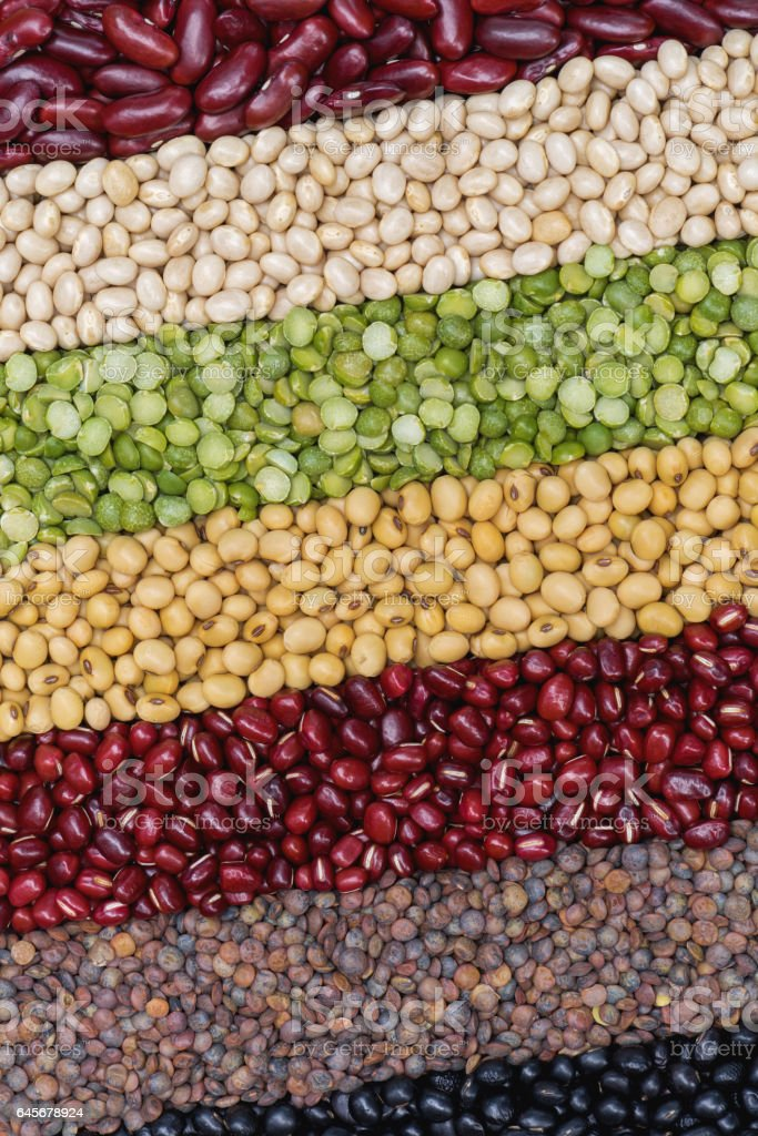 Multicolor dired legumes for diagonal background stock photo