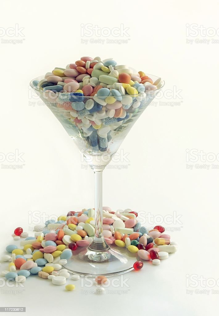 multicolor drugs and pils in glass royalty-free stock photo